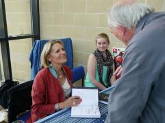 Jenny and Jess Horner, of Medina Publishing, talking to Professor Richard Hitchcock