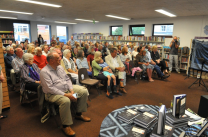 Peter Harrigan, director of Medina Publishing, front row left of a packed library at Crediton for 'Beyond Blues' event to launch Deeper than Indigo